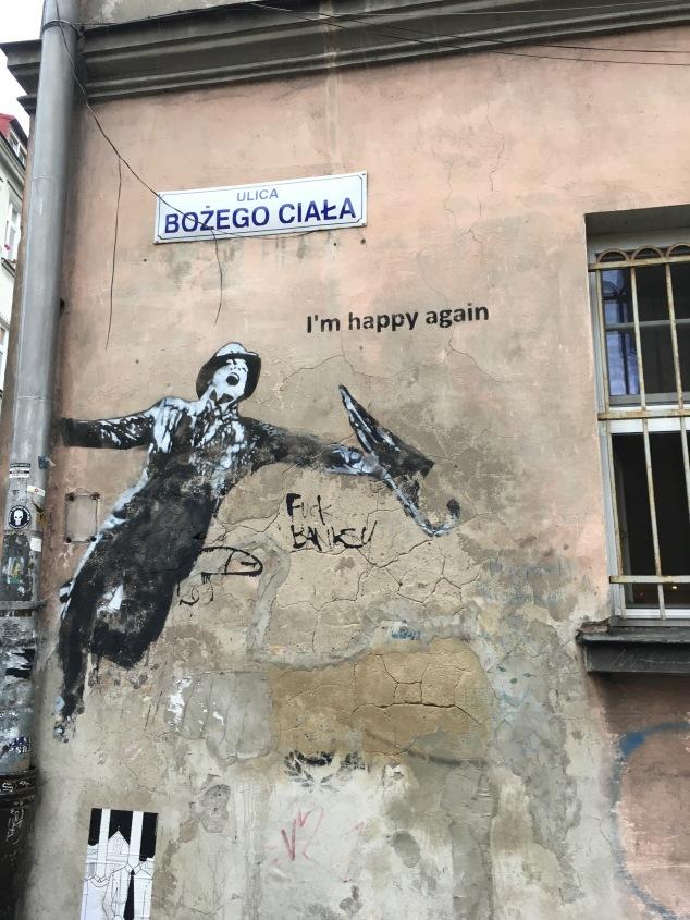 Singing in the Rain street art mural, Krakow